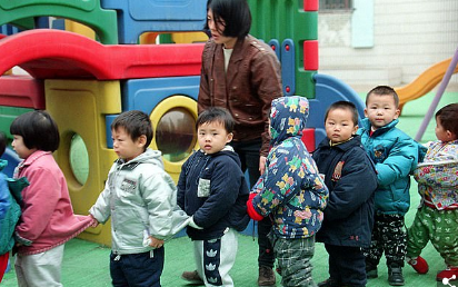Teacher and pupils in China
